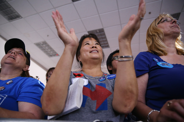 Supporters listen to Democratic presidential nominee Hillary Clinton during campaign rally at the Plumbers & Pipefitters Training Center on Wednesday, Nov. 2, 2016, in Las Vegas. Erik Verduzco ...