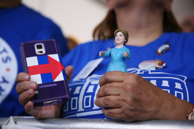 A supporter hold a figure of Democratic presidential nominee Hillary Clinton during campaign rally with Clinton at the Plumbers & Pipefitters Training Center on Wednesday, Nov. 2, 2016, in Las ...