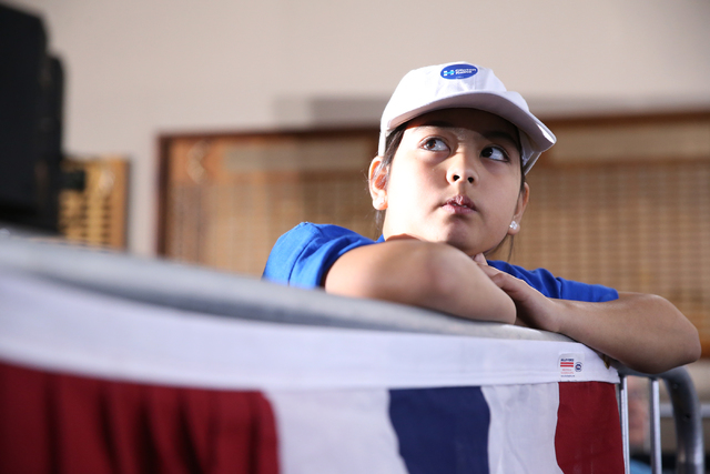 A young supporter listens to Democratic presidential nominee Hillary Clinton speak during a campaign rally at the Plumbers & Pipefitters Training Center on Wednesday, Nov. 2, 2016, in Las Vega ...