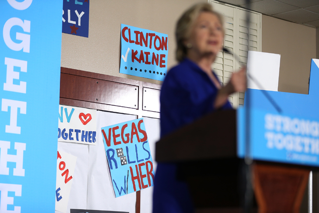 Signs on the wall are seen during a speech by Democratic presidential nominee Hillary Clinton speaking in a campaign rally at the Plumbers & Pipefitters Training Center on Wednesday, Nov. 2, 2 ...