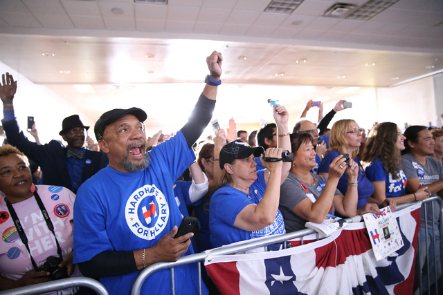 Supporters cheer for Democratic presidential nominee Hillary Clinton speaking in a campaign rally at the Plumbers & Pipefitters Training Center on Wednesday, Nov. 2, 2016, in Las Vegas. Erik V ...