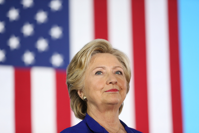 Democratic presidential nominee Hillary Clinton stands on stage waiting to speak for a campaign rally at the Plumbers & Pipefitters Training Center on Wednesday, Nov. 2, 2016, in Las Vegas. Er ...