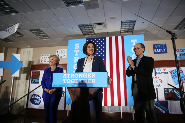 Democratic presidential nominee Hillary Clinton, from left, U.S. Senate candidate Catherine Cortez Masto, and U.S. Secretary of Labor Tom Perez, take the stage for a campaign rally for Clinton at  ...