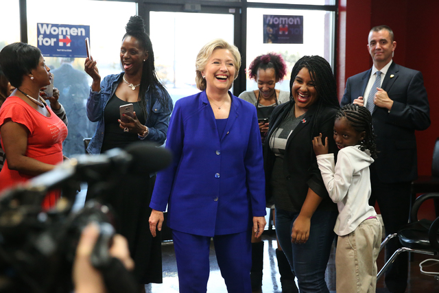 Democratic presidential nominee Hillary Clinton visits the newly opened small business, Nicky's African Hair Braiding salon, during a campaign tour on Wednesday, Nov. 2, 2016, in North Las Vegas.  ...