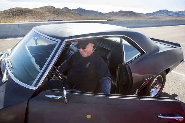 Car enthusiast John Thaxton gets into his 1969 Camaro Z28 1969, Saturday, Nov. 26, 2016, during Cars and Coffee, which meets every Saturday morning at SPEEDVEGAS in Las Vegas. Elizabeth Page Bruml ...