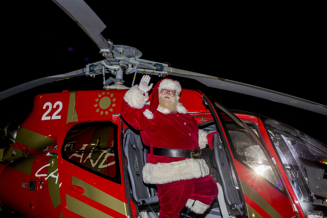Santa arrives for the 25th annual tree lighting ceremony at Opportunity Village in a helicopter, Friday, Nov. 25, 2016, Las Vegas. (Elizabeth Page Brumley/Las Vegas Review-Journal) Follow @ELIPAGE ...