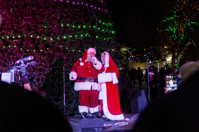 Santa and Mrs. Clause sing a duet for the 25th annual tree lighting ceremony at Opportunity Village in a helicopter, Friday, Nov. 25, 2016, Las Vegas. (Elizabeth Page Brumley/Las Vegas Review-Jour ...