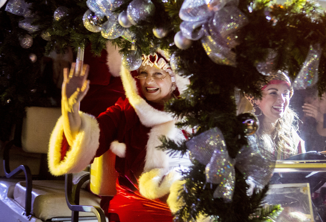 Mrs. Clause waves to people as she enters into the 25th annual tree lighting ceremony at Opportunity Village in a helicopter, Friday, Nov. 25, 2016, Las Vegas. (Elizabeth Page Brumley/Las Vegas Re ...