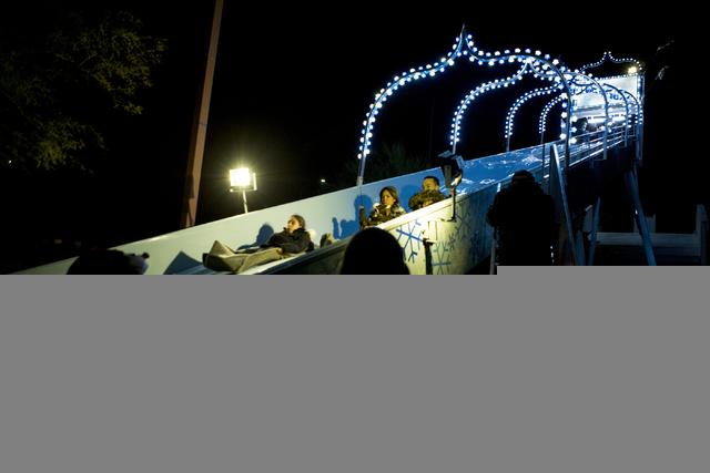 People enjoy a slide at the Opportunity Village, Friday, Nov. 25, 2016, Las Vegas. (Elizabeth Page Brumley/Las Vegas Review-Journal) Follow @ELIPAGEPHOTO