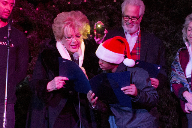Las Vegas Mayor Carolyn Goodman, left, OVIP Reggie, center, and President and CEO of Opportunity Village, Bob Brown, introduce the 25th tree lighting ceremony at Opportunity Village, Friday, Nov.  ...