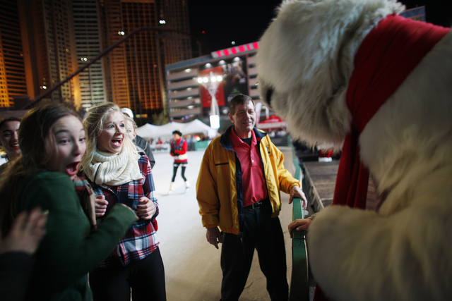Chianna Rodriguez, from left, and Michelle Rudzki laugh at the Coca-Cola bear on Monday, Nov. 21, 2016, at the tree lighting ceremony at The Park in Las Vegas. Rachel Aston/Las Vegas Review-Journa ...
