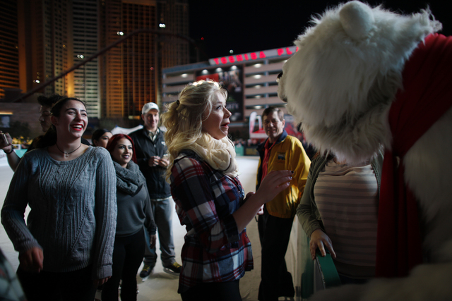 Michelle Rudzki moves closer to touch foreheads with the Coca-Cola bear on Monday, Nov. 21, 2016, at the tree lighting ceremony at The Park in Las Vegas. Rachel Aston/Las Vegas Review-Journal Foll ...