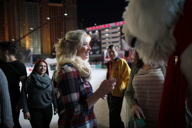 Michelle Rudzki smiles after touching foreheads with the Coca-Cola bear on Monday, Nov. 21, 2016, at the tree lighting ceremony at The Park in Las Vegas. Rachel Aston/Las Vegas Review-Journal Foll ...