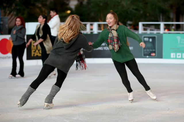 Twins Alexa and Chianna Rodriguez skate on Monday, Nov. 21, 2016, at the tree lighting ceremony at The Park in Las Vegas. Rachel Aston/Las Vegas Review-Journal Follow @rookie__rae