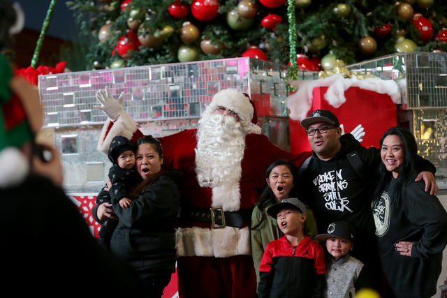 The Ancheta family poses with Santa Claus on Monday, Nov. 21, 2016, at the tree lighting ceremony at The Park in Las Vegas. Rachel Aston/Las Vegas Review-Journal Follow @rookie__rae