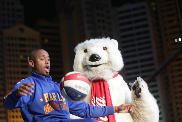 Scooter Christensen of the Harlem Globetrotters performs a trick with the Coca-Cola Bear on Monday, Nov. 21, 2016, at the tree lighting ceremony at The Park in Las Vegas. Rachel Aston/Las Vegas Re ...