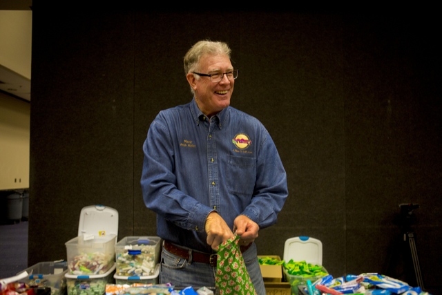 "Henderson Mayor Andy Hafen fills stockings for troops serving overseas during the 8th annual ""Stockings for our Troops,"" at Henderson City Hall, Tuesday, Nov. 29, 2016, in Hender ..."
