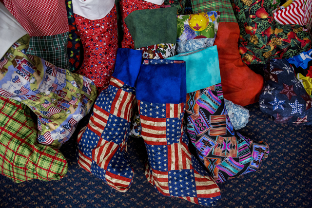 "Stockings to be sent to active troops overseas filled by students from Gordon McCaw Elementary School are pictured during the 8th annual ""Stockings for our Troops,"" at Henderson  ..."