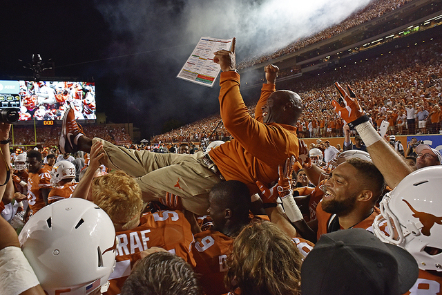 GABRIEL LOPEZ/THE DAILY TEXAN VIA AP Texas head coach Charlie Strong is carried by players after defeating Notre Dame in double overtime in Austin, Texas on Sept. 4, 2016. Texas is ranked for the  ...