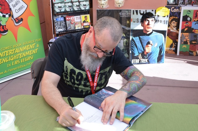 Artist J.H. Williams III signs a Sandman book at Alternate Reality Comics book at the Vegas Valley Comic Book Festival, Nov 4, 2016, at the Clark County Library. (Ginger Meurer/Special to View)
