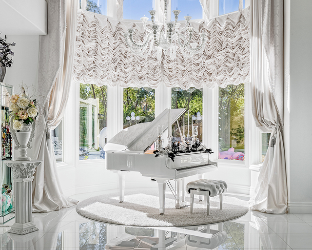 David Reisman/Real Estate Millions The remodeled home includes a concert hall with a piano.