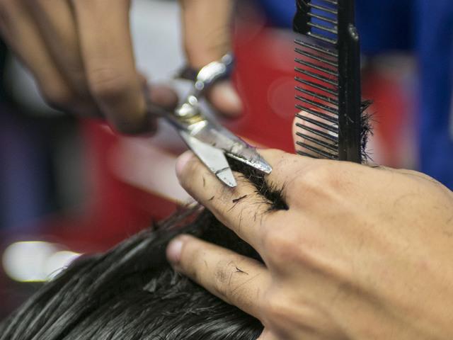 Barber student Gabriel Avila, 21 trims the hair of fellow student Robert Luna, 22, during class at the Masterpiece Barber College in Las Vegas, Thursday, Oct. 20, 2016. (Richard Brian/Las Vegas Re ...