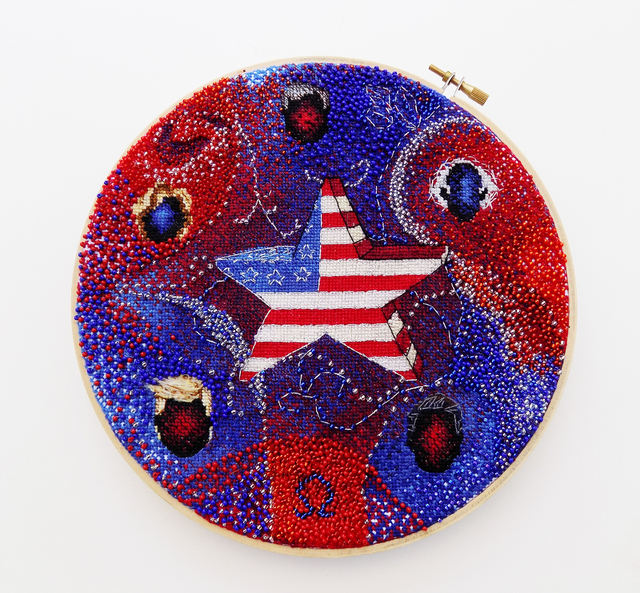 Jeanne Voltura's star-spangled needlework piece depicts candidate hairstyles (including, inevitably, Donald Trump's distinctive coiffure. (Diane Bush)