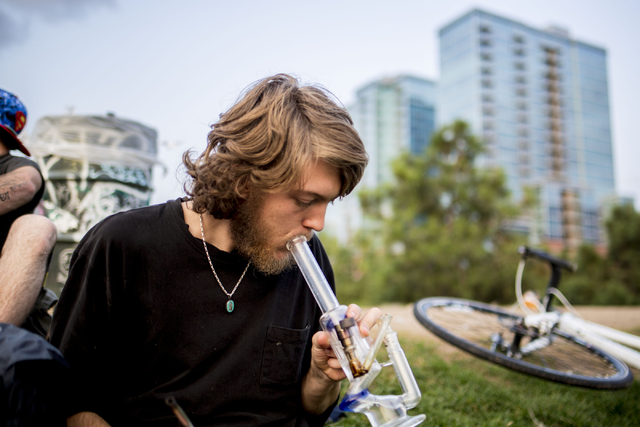 Denver Colorado local Atticus, takes a hit of marijuana in Commons Park, Wednesday, Aug. 31, 2016, in Denver. (Elizabeth Page Brumley/Las Vegas Review-Journal Follow @ELIPAGEPHOTO)