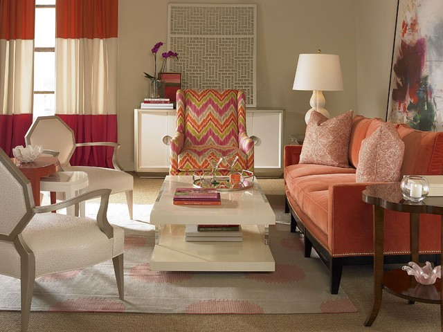 COURTESY The cream-colored walls act as a neutral backdrop to the brightly colored sofa and chair.