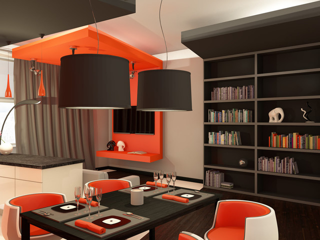 COURTESY The orange shelf and lowered ceiling piece provides a pop of colored and tie the room together.