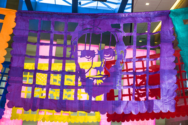 """The face of Abraham Lincoln hovers over the Las Vegas City Hall lobby as part of artist Justin Favela's """"Patrimonio,"""" which continues on display through Dec. 15. Benjamin Hager/Las Vegas Review-Jo ..."""
