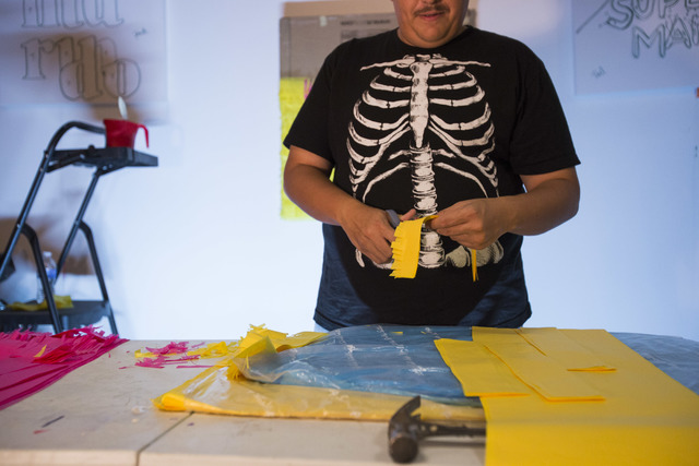 Working on a commissioned piece, artist Justin Favela hand-cuts strips of tissue paper inside his studio at the Juhl in downtown Las Vegas. Richard Brian/Las Vegas Review-Journal Follow @vegasphot ...