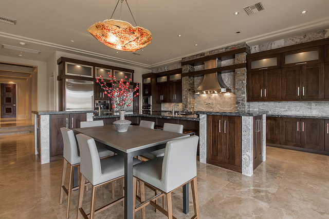 Michael Mossholder Mossholder said the UFC staff chefs who cater his parties love the large kitchen with Viking appliances and the 1200 CFM stainless-steel chimney range hood, which the builder sa ...