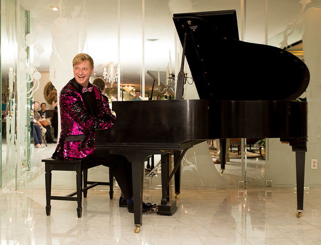 """Fuchsia-and-black sequined jacket pianist Bryant Olender from Vancouver then took over the grand piano to play Liberace's famed arrangement of """"Chop Sticks"""" and a fancy version of """"Beer Ba ..."""