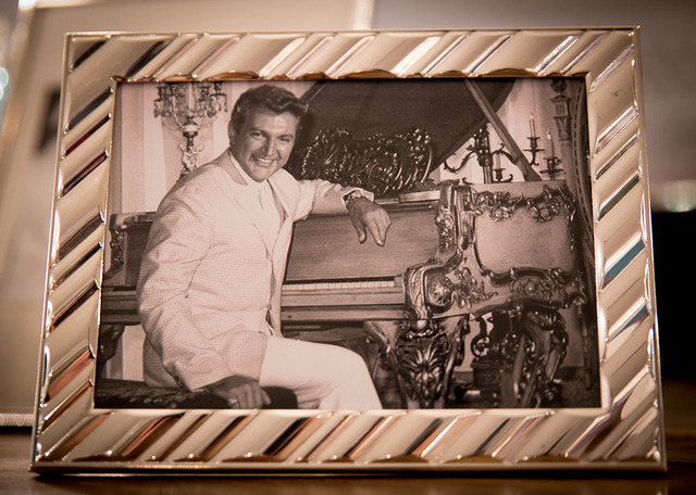 The mansion displays photos of Liberace in his younger years. (Tonya Harvey/Real Estate Millions)