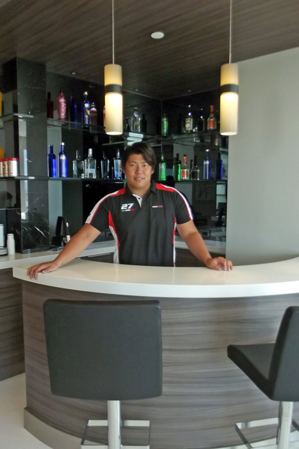 Courtesy of Rahimi Designs Residences at Mandarin Oriental penthouse owner at his bar.