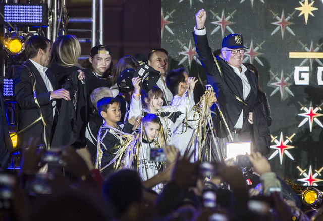 Golden Knights owner Bill Foley, right, celebrates at the conclusion of a ceremony to unveil the Las Vegas' NHL expansion franchise's official team nickname, logos and colors on Tuesday, Nov. 22,  ...