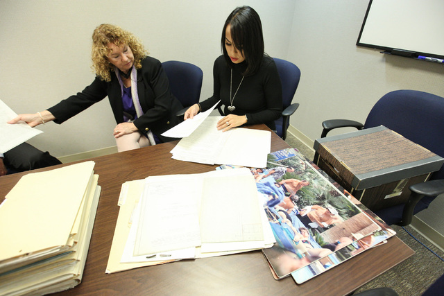 Lynn Goya, Clark County Clerk, left, and senior office specialist Rocio Leon show of some of the records that are being digitized at the Clark County Government Center in Las Vegas on Tuesday, Nov ...