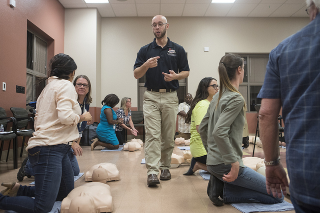 EMS physician Travis Marshall teaches community members how to give proper CPR at the East Las Vegas Community Center Oct. 13, 2016. Loren Townsley/View Follow @lorentownsley