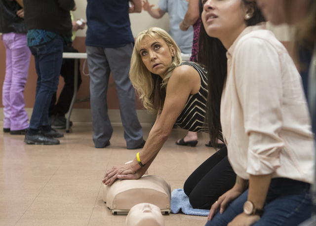 Tina Merced practices doing CPR on a manikin at the East Las Vegas Community Center Oct. 13, 2016. Loren Townsley/View Follow @lorentownsley