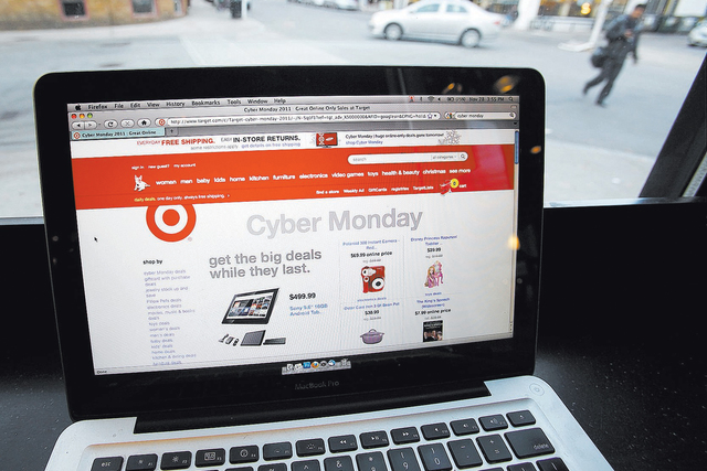 The Target web site is shown on a computer screen at a coffee shop in Providence, R.I. Monday, Nov. 28, 2011. Shoppers spent $3.45 billion this year on Cyber Monday on Samsung 4K TVs, PlayStation  ...