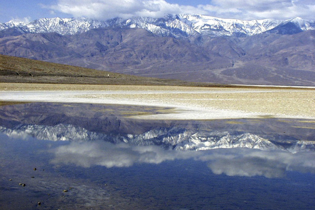 Death Valley National Park is home to Badwater, seen here, which, at an elevation of 282 below sea level, is the lowest point in North America. To the west lies the snow-capped Telescope Peak in t ...