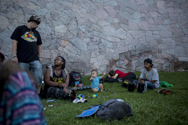 A group of friends listen to music and smoke marijuana at Commons Park in Denver Colorado, Friday, Sept. 2, 2016. (Elizabeth Page Brumley/Las Vegas Review-Journal Follow @ELIPAGEPHOTO)