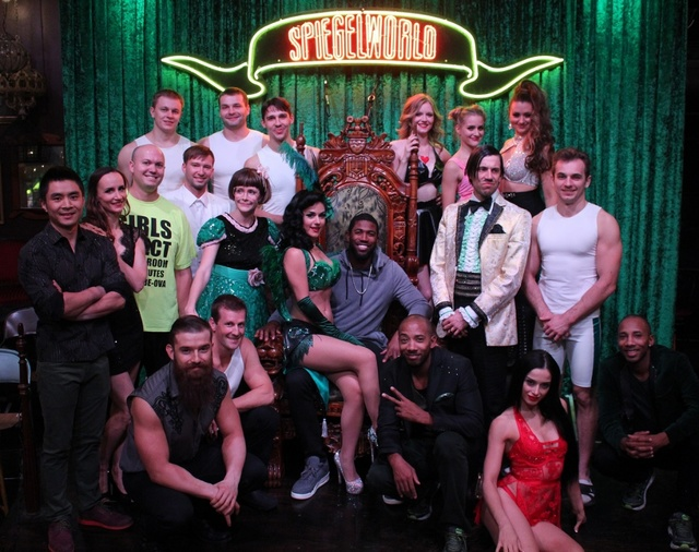 "Dexter Fowler of the world champion Chicago Cubs poses with ""Absinthe"" cast Saturday. (Spiegelworld)"