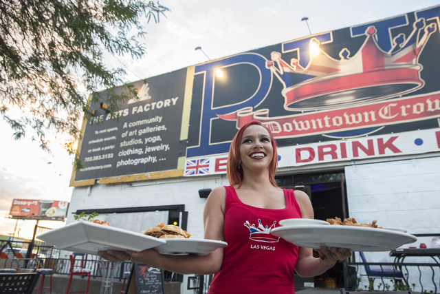 Server Madison Fisher brings out plates of food at the Downtown Crown on Friday, Oct. 28, 2016, in Las Vegas. (Benjamin Hager/Las Vegas Review-Journal)
