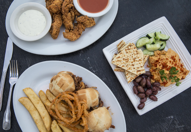 Vegetarian tomato hummus plate, chicken fingers and barbecue pulled pork sliders at the Downtown Crown on Friday, Oct. 28, 2016, in Las Vegas. (Benjamin Hager/Las Vegas Review-Journal)