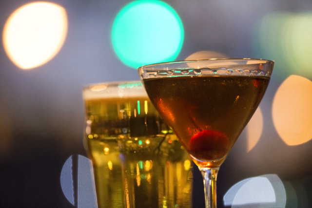 A Manhattan cocktail and Carlsberg beer at the Downtown Crown on Friday, Oct. 28, 2016, in Las Vegas. (Benjamin Hager/Las Vegas Review-Journal)