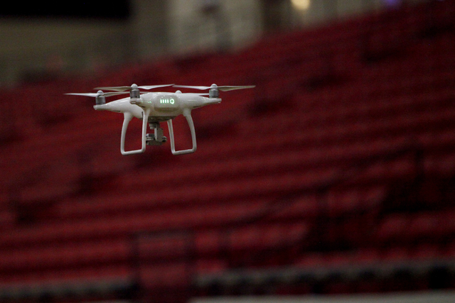 A DJI Phantom 4 UAV piloted by students during a pilot training course by AviSight Aerial and Drone Services, crosses the South Point Equestrian Arena on Thursday,  Aug. 25, 2016. (Michael Quine/L ...