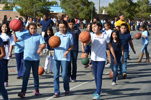 "More than 300 students at Sandy Searles Elementary School participated in a ""Tough Mooser"" competition held Oct. 31 at 4851 E. Lake Mead Blvd. The outdoors obstacle course, named after the school' ..."