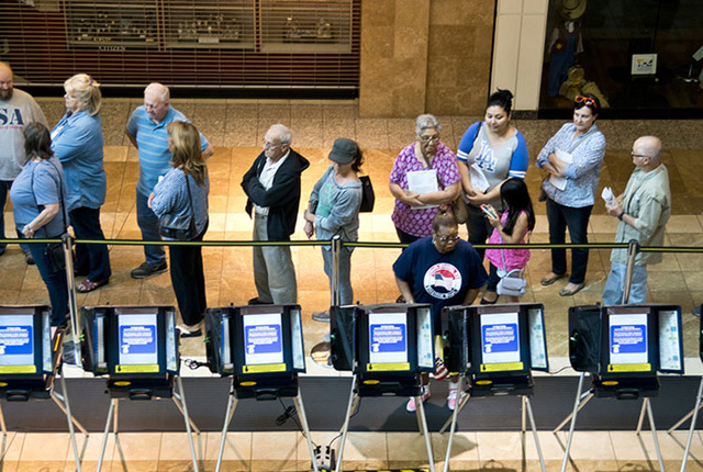 Voters stand in line to be among the first to vote in Nevada during early voting at the Galleria at Sunset in Henderson on Oct. 22, 2016. (Daniel Clark/Las Vegas Review-Journal)